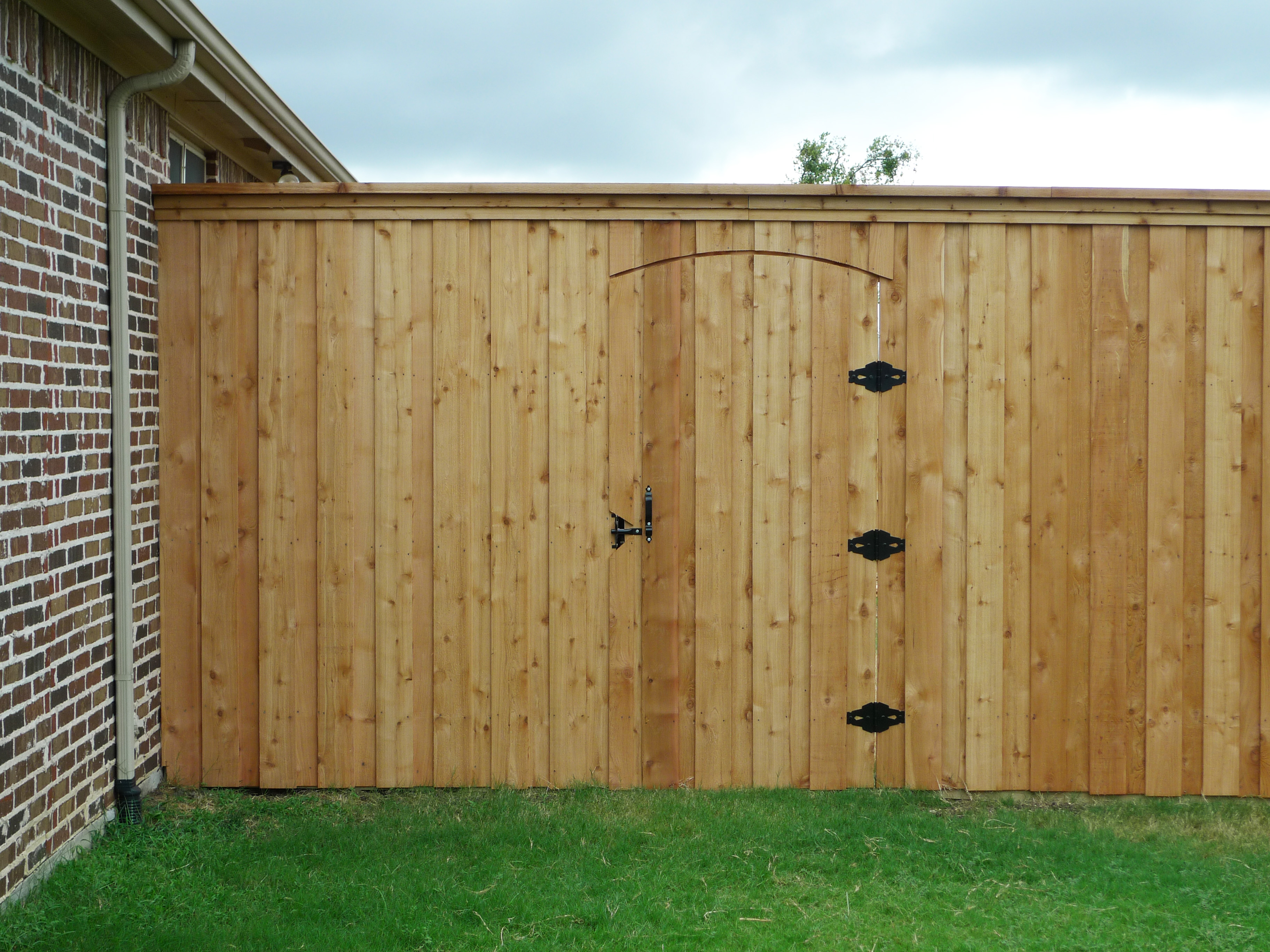 Frisco fence llc quality and value for north texas 8 foot unstained cedar board on board fence with electric gate baanklon Images