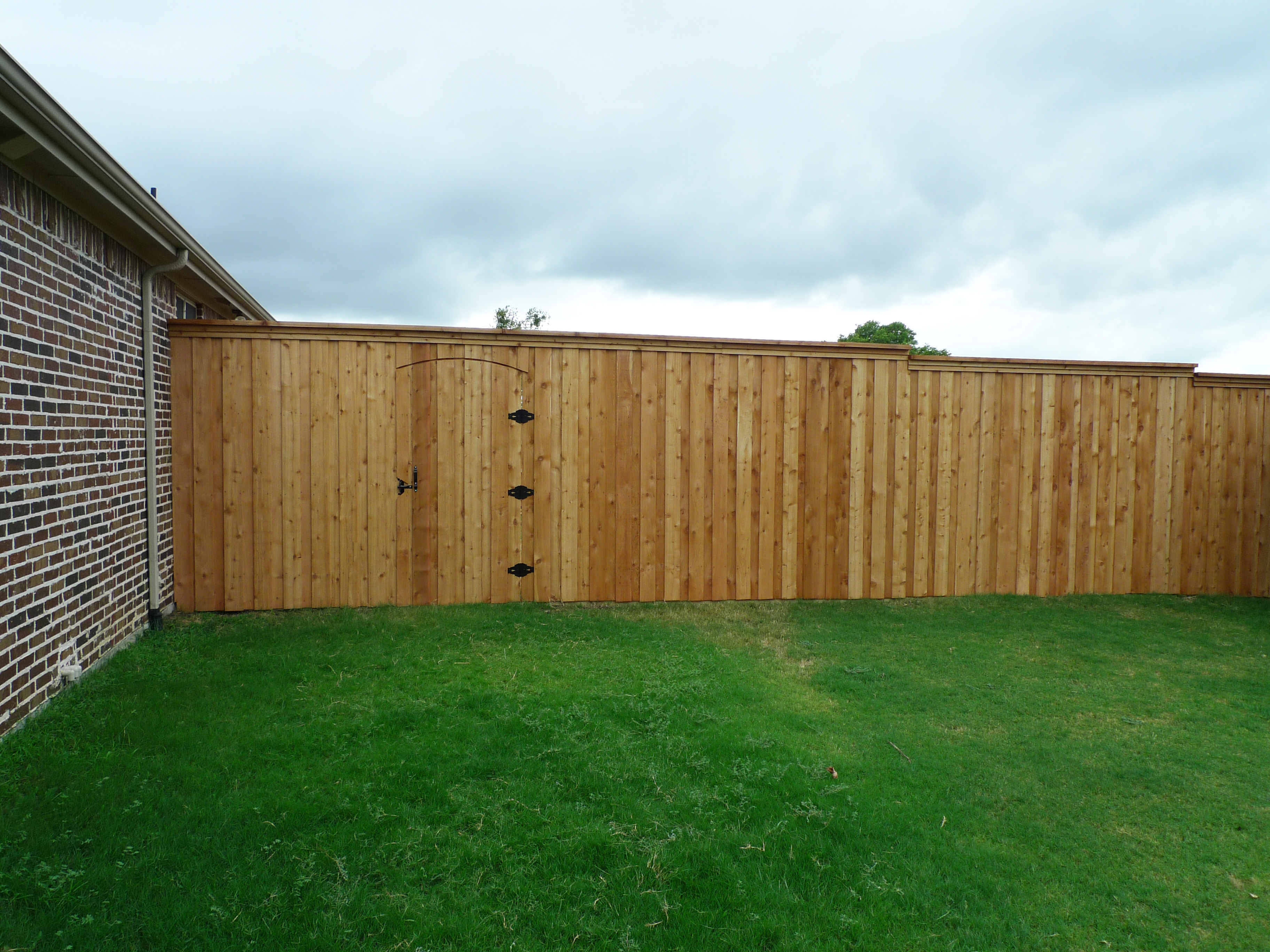 8 Foot Unstained Cedar Board On Board Fence With Electric